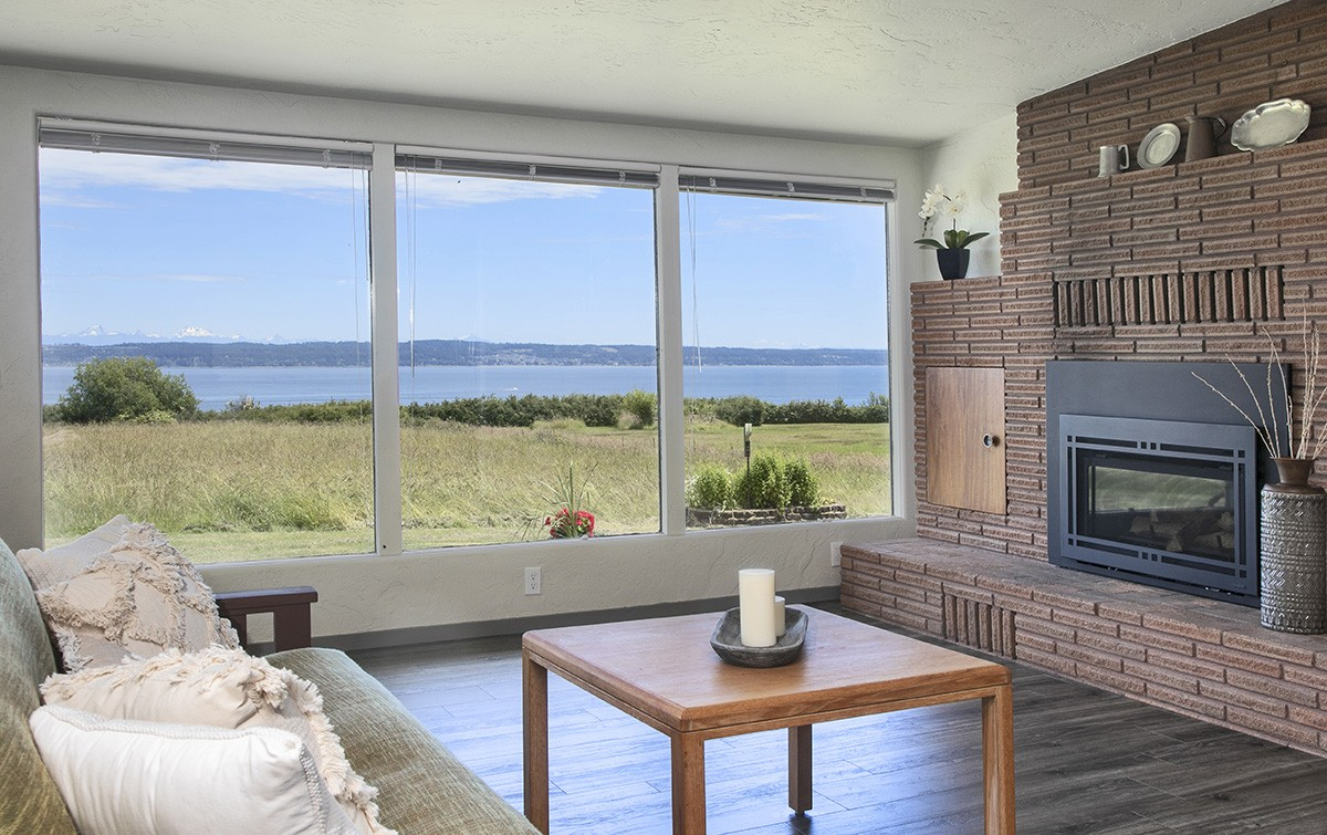 Cozy gas fireplace while you gaze out over the stormy waters.